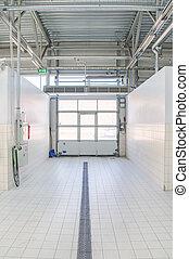 Hand car wash facility. Entrance view.