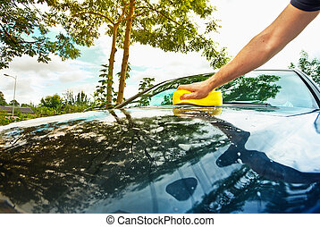 hand car wash in the sunny day