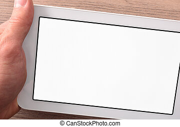 Hand catching white tablet with white screen on wood table