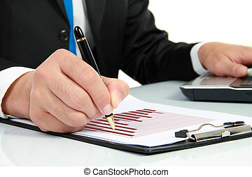 hand checking at diagram on financial report - Businessman's...