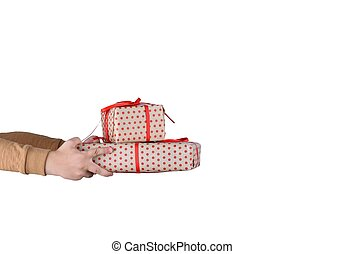 Hand child holding gift box on isolated with clipping path. Image of christmas gift with red bow placed on female hand isolated white.
