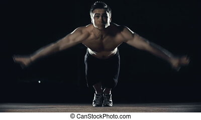 Hand Clap Push Ups - Front view of sportsman with naked...