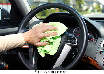 Hand cleaning car. - Hand with microfiber cloth cleaning car...