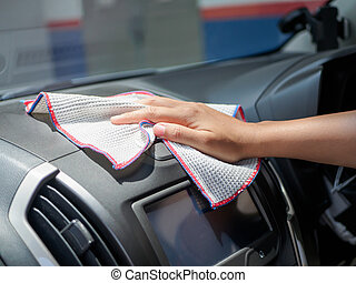 Hand cleaning interior car with microfiber cloth