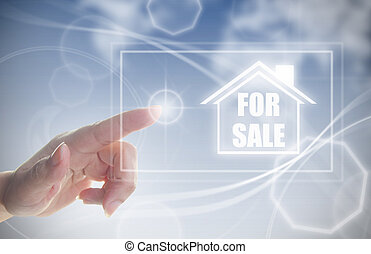 Hand clicking on house for sale