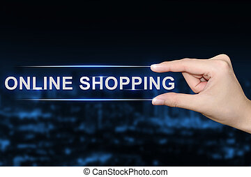 hand clicking online shopping button