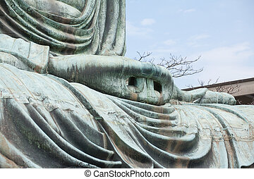 Hand close-up of the Daibutsu in Kamakura - Japan