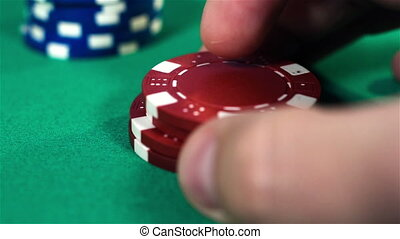 Hand Collects Poker Chips - Dealer Hand Collects Poker...
