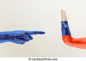 Hand colored in flags of EU and Russia - Confrontation, ...
