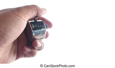 hand counting clicker machine on isolated - close up hand...