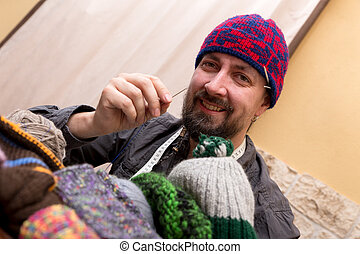 hand crafting man with wool hat