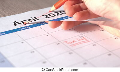 Hand Cross out Tax day on April 2020. Filing deadline pushed back to July 15.