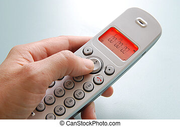 hand dialing the phone with shallow background
