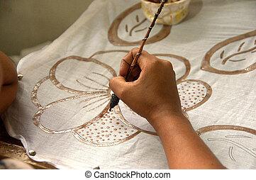 hand doing batik work