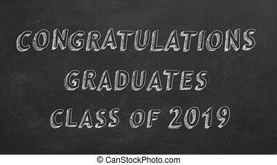 """Hand drawing and animated text """"Congratulations graduates. Class of 2019."""" on blackboard. Stop motion animation."""