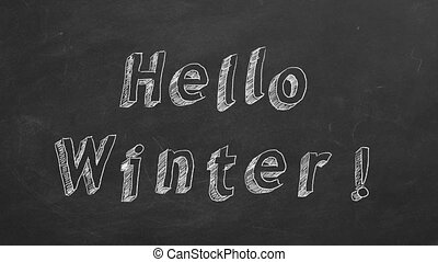 """Hand drawing and animated text """"Hello Winter"""" on blackboard. Stop motion animation."""