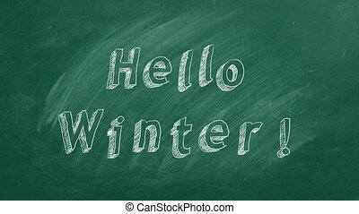 """Hand drawing and animated text """"Hello Winter"""" on green chalkboard. Stop motion animation."""