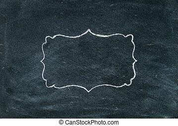 Hand drawing chalk frame on blackboard