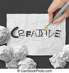 hand drawing  design word CREATIVE on crumpled paper with as concept