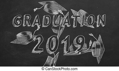 "Hand drawing ""Graduation 2019"" and graduation caps on blackboard"