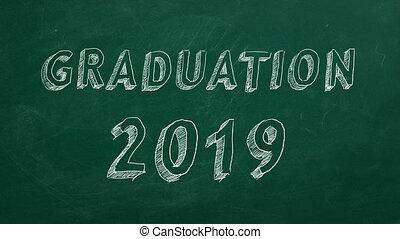 "Graduation 2019 - Hand drawing ""Graduation 2019"" on green..."