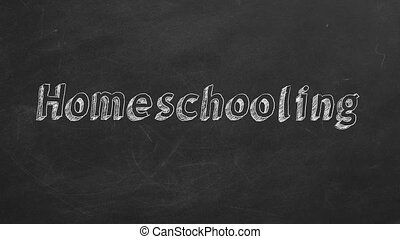 """Hand drawing """"Homeschooling"""" on black chalkboard. Stop motion animation."""