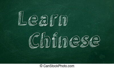 "Learn Chinese - Hand drawing ""Learn Chinese"" on green..."