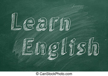"Learn English - Hand drawing ""Learn English"" on green ..."
