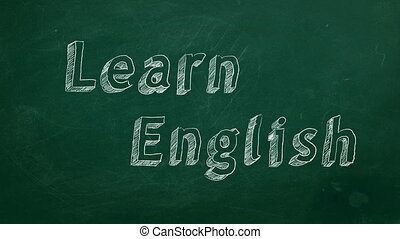 "Learn English - Hand drawing ""Learn English"" on green..."