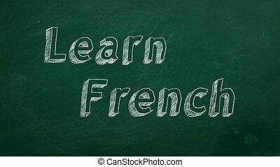"Learn French - Hand drawing ""Learn French"" on green..."