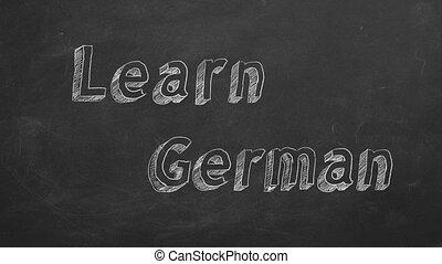 """Learn German - Hand drawing """"Learn German"""" on blackboard...."""