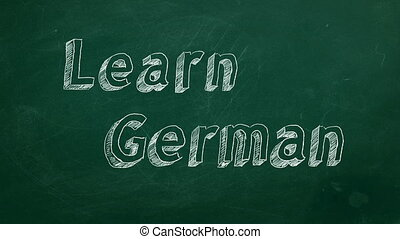 "Learn German - Hand drawing ""Learn German"" on green..."