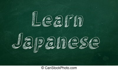 "Hand drawing ""Learn Japanese"" on green chalkboard"
