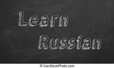 """Learn Russian - Hand drawing """"Learn Russian"""" on blackboard. ..."""