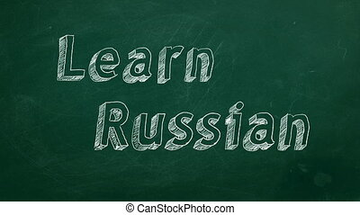 "Learn Russian - Hand drawing ""Learn Russian"" on green..."