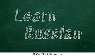 "Learn Russian - Hand drawing ""Learn Russian"" on green..."