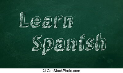 "Learn Spanish - Hand drawing ""Learn Spanish"" on green..."