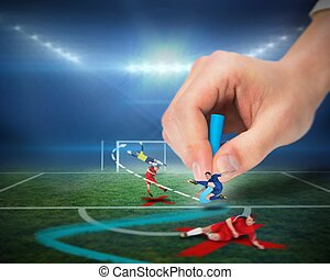 Hand drawing tactics on football pi - Digital composite of...