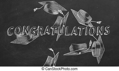 "Hand drawing text ""Congratulations"" and graduation caps on blackboard."