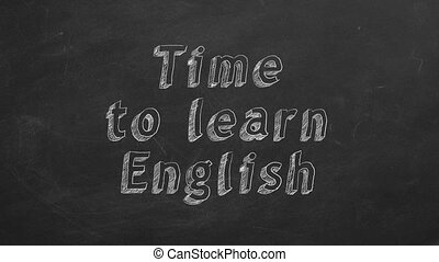 """Hand drawing """" Time to learn english"""" on black chalkboard. Stop motion animation."""
