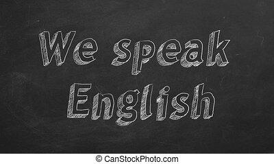 "Hand drawing ""We speak English"" on black chalkboard. Stop motion animation."