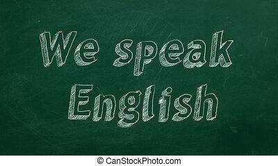 "Hand drawing ""We speak English"" on green chalkboard"