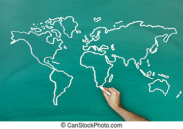 Hand drawing world map on blackboard