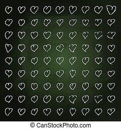 Hand drawn chalk illustration of hearts on a blackboard background