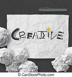hand drawn  design word CREATIVE on crumpled paper with as concept