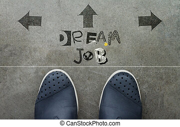 Hand drawn DREAM JOB design word on front of business man feet as concept