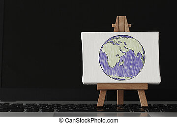 hand drawn globe with social network diagram on canvas and woode