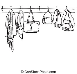Hand drawn illustration with fashionable clothes on hangers on white background.