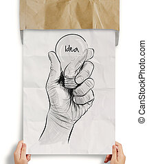 Hand drawn light bulb with IDEA word on crumpled paper as concept