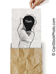 Hand drawn light bulb with THINK word on crumpled paper as concept